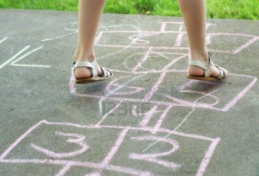 13565084-girl-playing-hopscotch